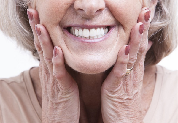 Close-up of a senior woman smiling.