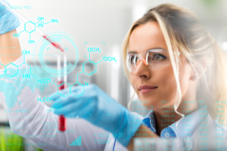 Female scientist researching in laboratory.