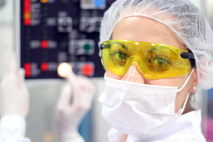 Pharmacy Technician wearing a hairnet, goggles, and face mask.