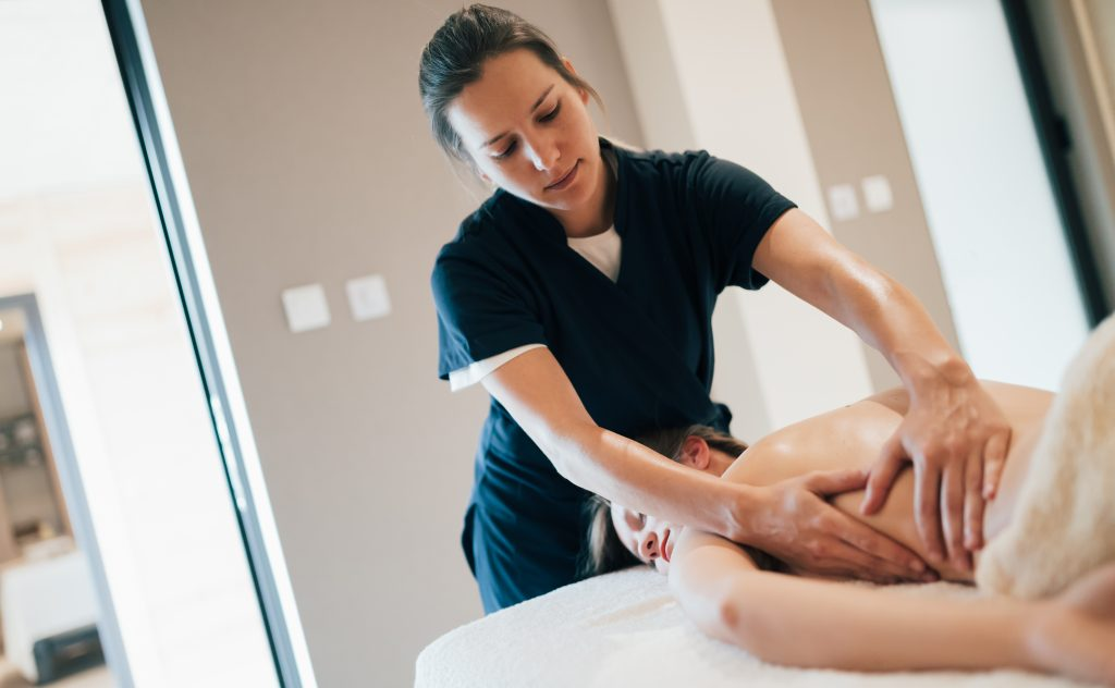 Female receiving a massage from a female massage therapist.