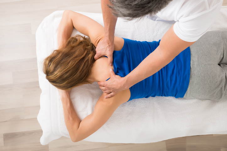 High angle view of woman receiving massage.