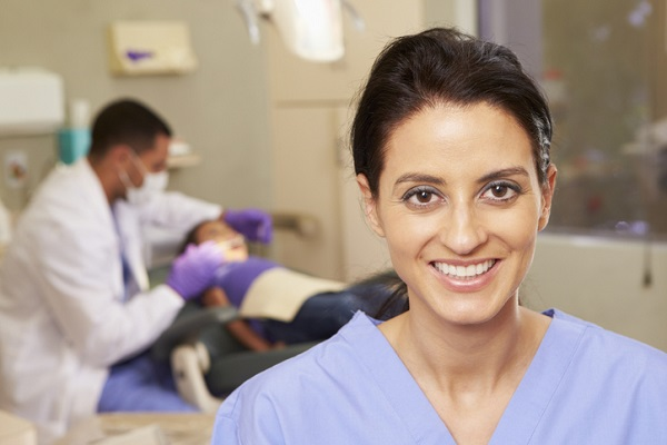 Portrait Of Dental Nurse In Dentists Surgery Smiling To Camera